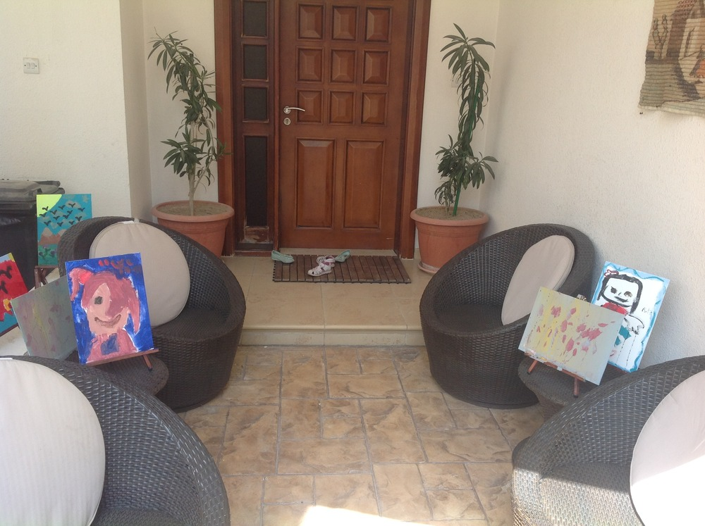Our outdoor drying gallery after the fake birthday party in May.  Some masterpieces here I do believe.