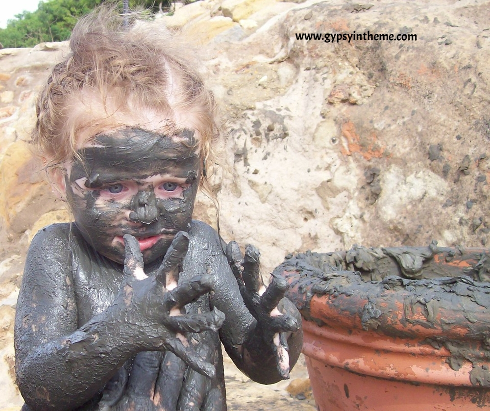 A very young Kiddo ... obviously not convinced there's anything medicinal about the Dead Sea mud ...