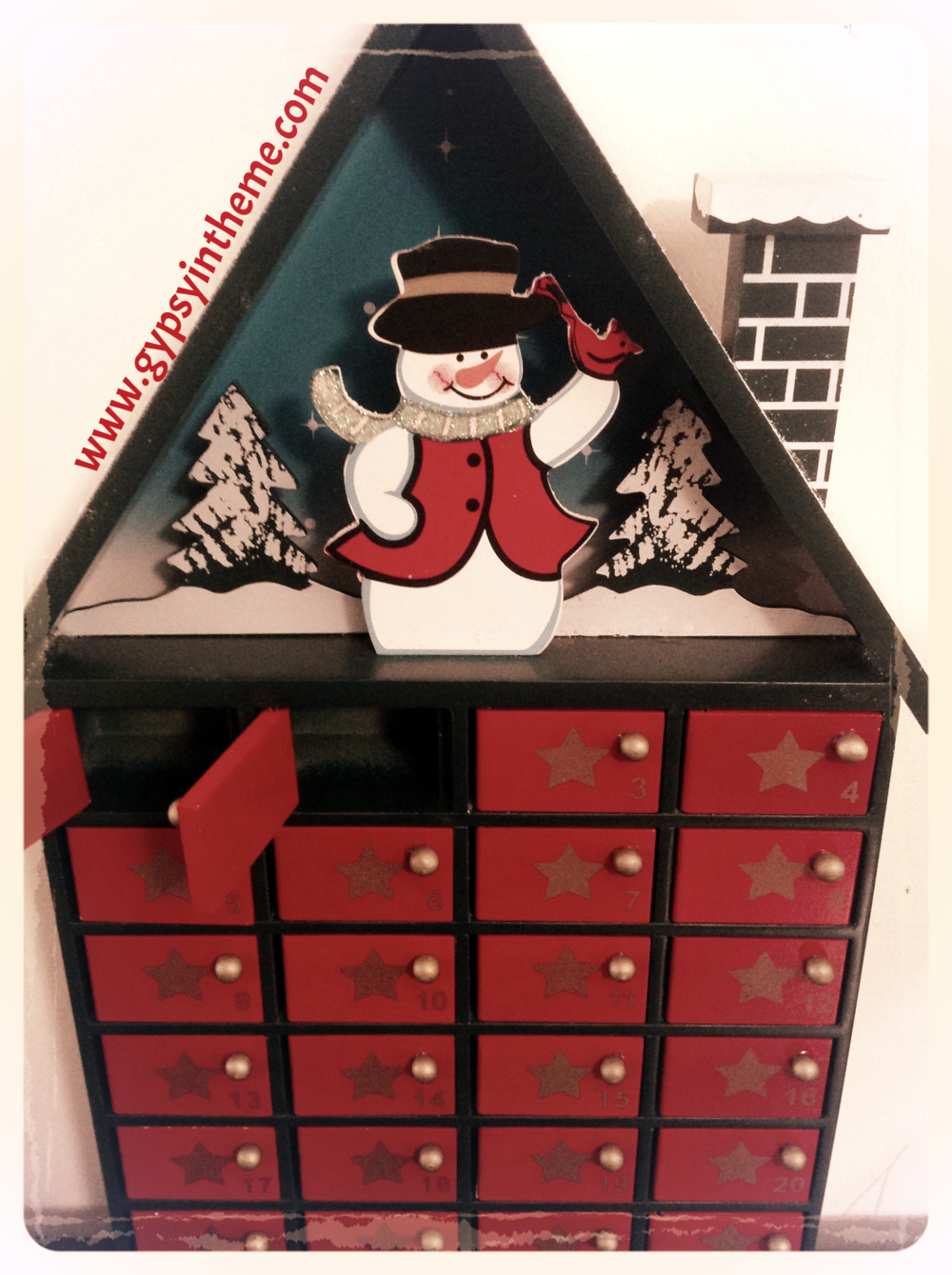 First Christmas decoration I purchased in Qatar (2007) - A wooden advent calendar from Carrefour.  We take it out each year on December 1 to kick off the Holiday Season.   This year, each door hides either a mini Mars bar, mini TicTac box, Double Bubble gum, or mini Smarties box.