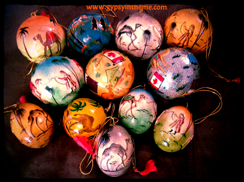Christmas paper maché ornaments depicting desert scenes and some with Canadian/Qatari flags.  These are a favourite to bring back to Canada as gifts; made by a very nice man from Kashmir who shows up at all the Christmas fairs in Doha.
