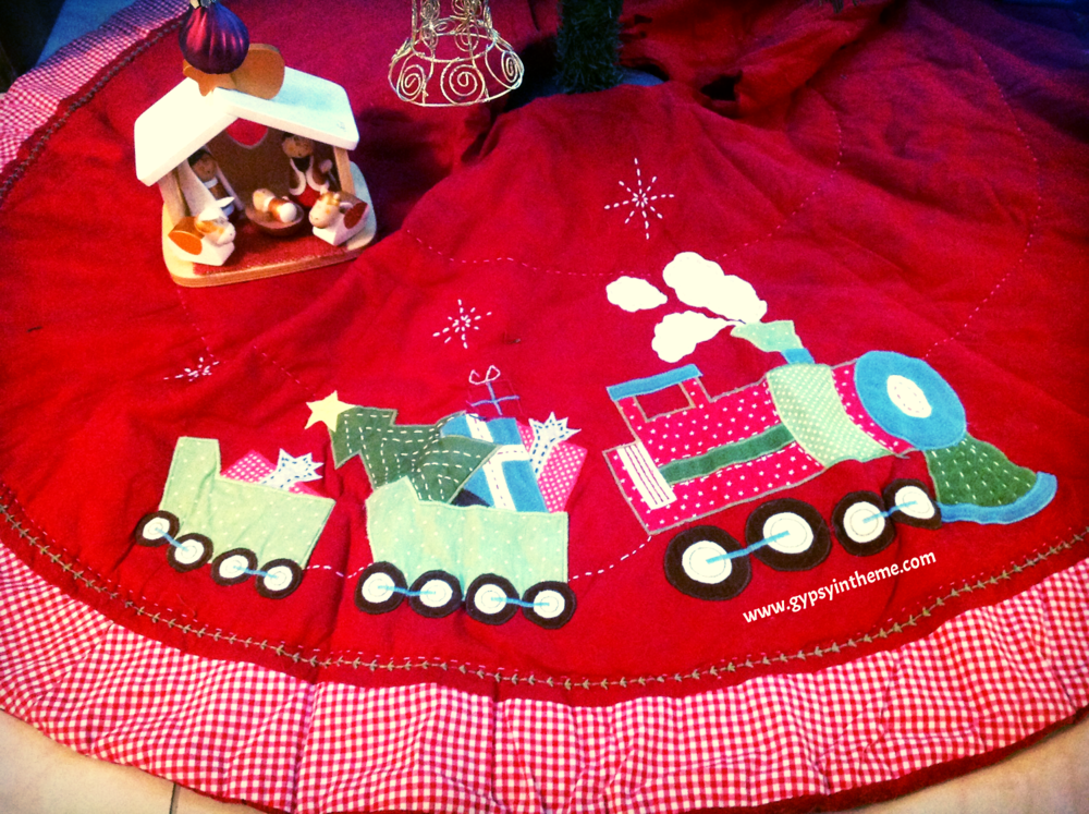 Tree skirt bought during a spontaneous trip to Manama, Bahrain with Smilin' Vic.  At Pottery Barn, of all places!  I loved Bahrain in December; despite the unrest which remained when we visited in 2012, the malls were a bastion of Holiday cheer.  It really felt like being back home, and I often find myself longing to go back to visit.