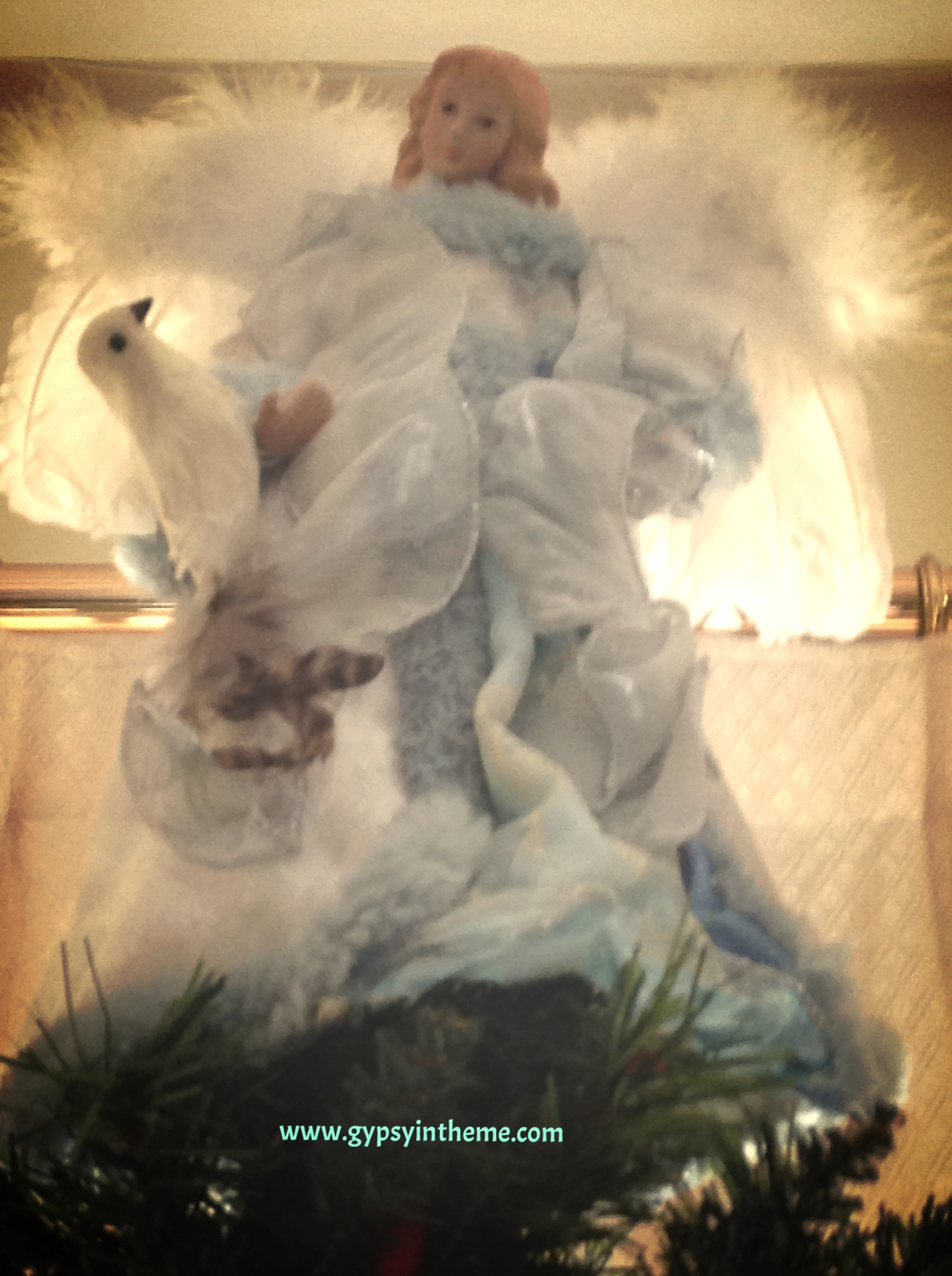 The angel that sits upon our tree each year, given to me by my mom to celebrate a new beginning with Smilin' Vic the year Kiddo was born.  It meant a lot for her to recognise the new beginnings.