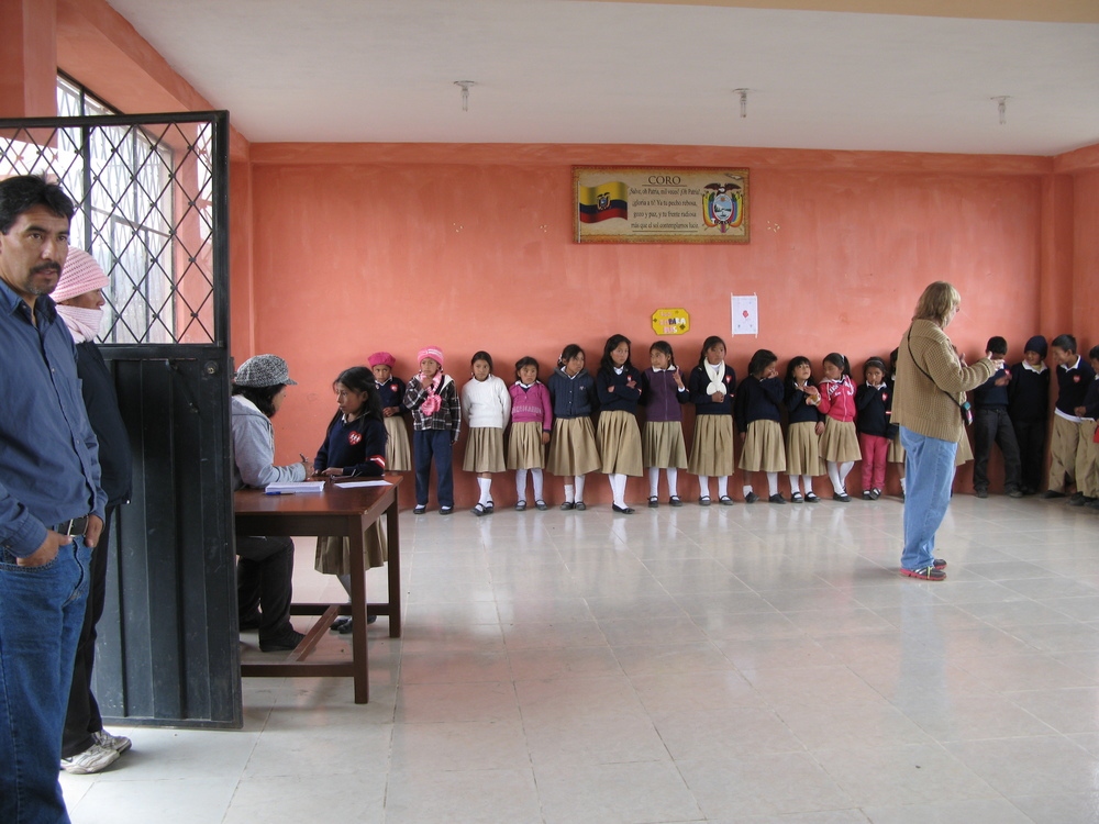 That's pastor Hernan on the left with the kids lining up to receive parasite medicine