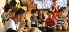 Keishi praying with the children.