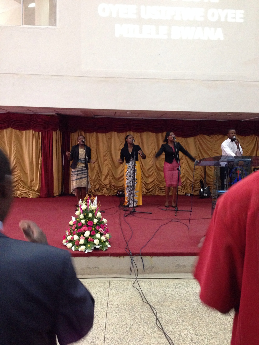 Worshiping at Joyce & Onesmus Weru's church.