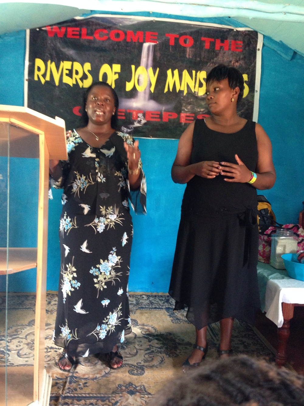 Nancy our interpreter and the pastor's wife with Joyce