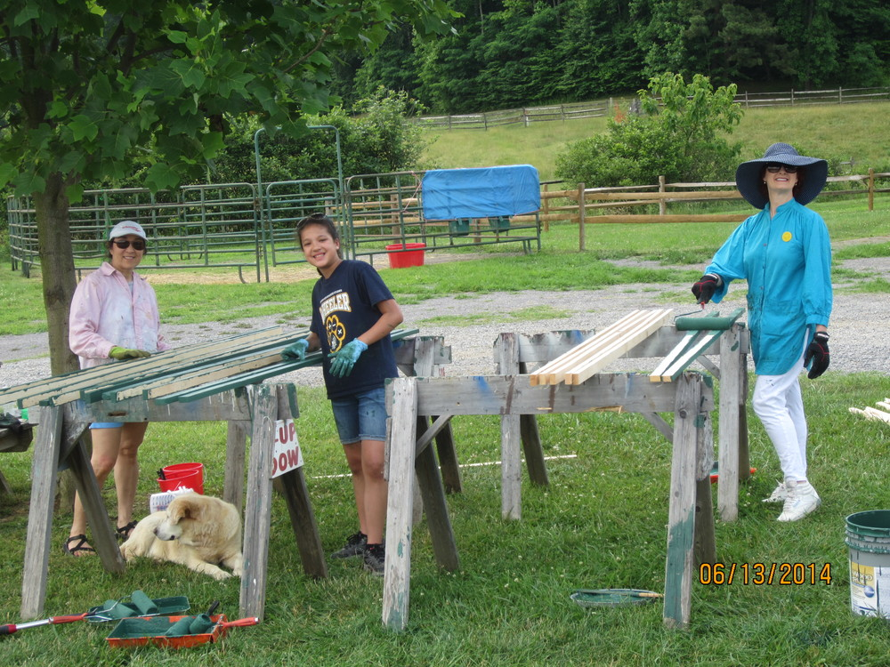 Staining the curtain wall trim.  Nellie More, Abbey Mayfield and Carol Johnson.