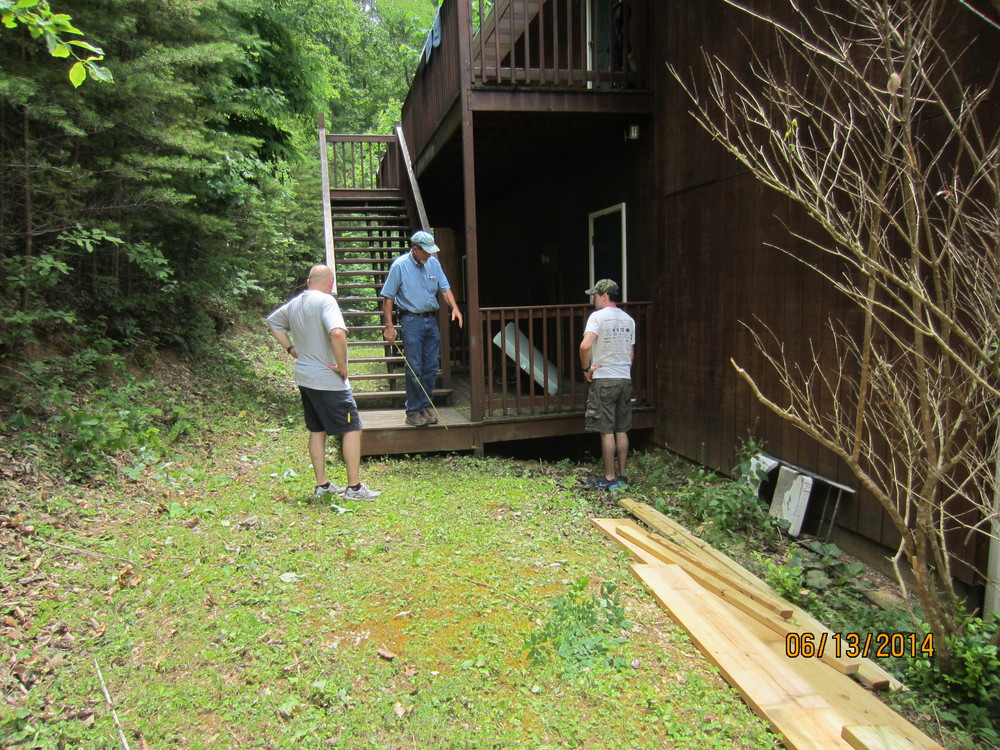 Preparing to build new steps at the Dormatory.  Evan and Phillip Stout with Mr. Pat.