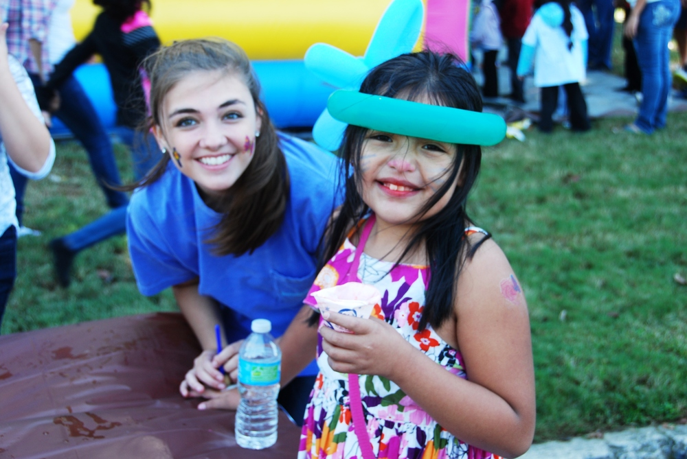 We had almost 300 kids and their families come through the event and participate in face painting, games, inflatable slides, salvation bracelets, pumpkin painting, and more!