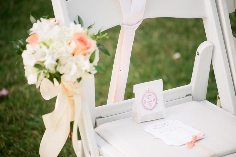 Ceremony Chair w-Program Seed Bag Flowers.jpg