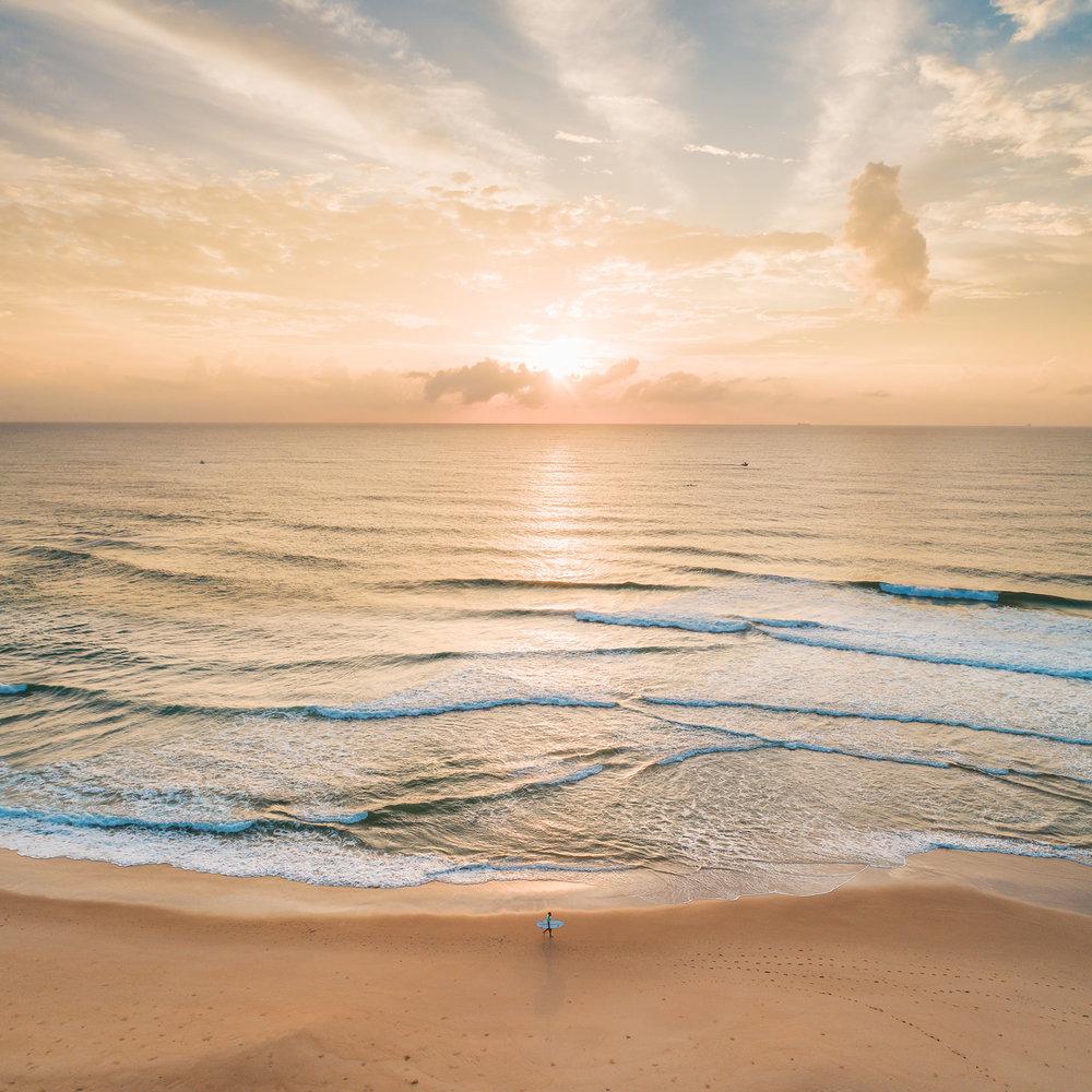 Point-Cartwright-sunrise-surfer.jpg