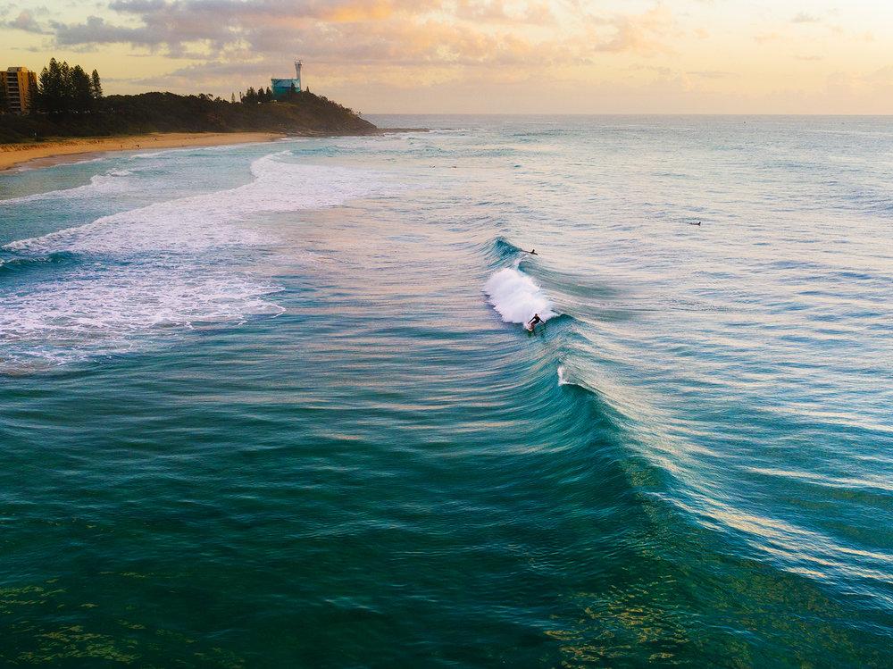 Point-Cartwright-Surfer-Lighthouse-background-copy.jpg