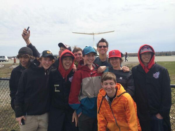 Students pose with Jim Carrey at Peterborough Airport. Pic via @ZachPremate