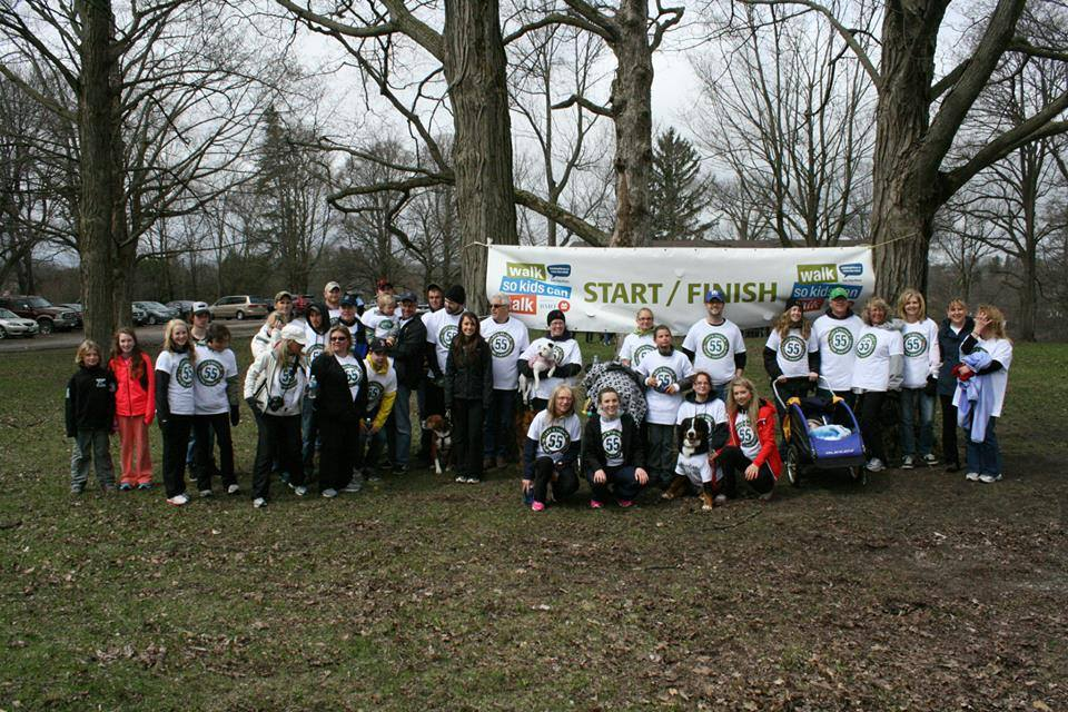 Team 55 gathers by the finish line at the end of the walk
