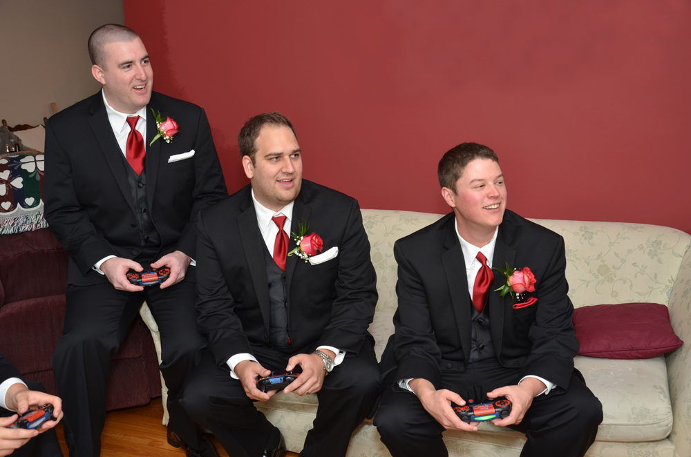 Ryan (far right) gaming on his wedding day last month with his groomsmen