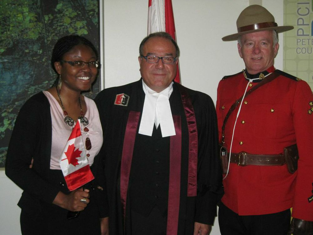 Peterborough's Kemi Akapo receiving her citizenship in 2012 ceremony
