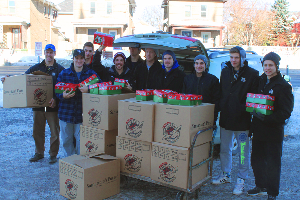 Petes players with all the boxes donated