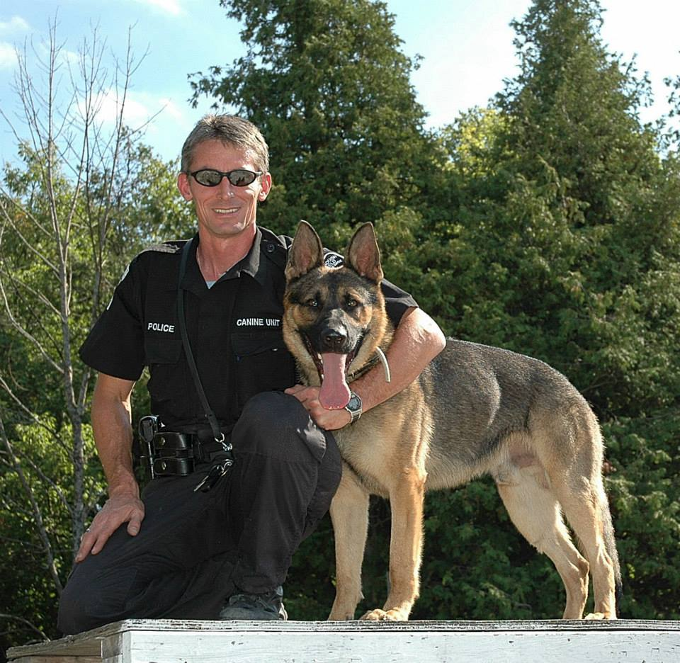 Sergeant Jeff Chartier with his K9 partner Harris.