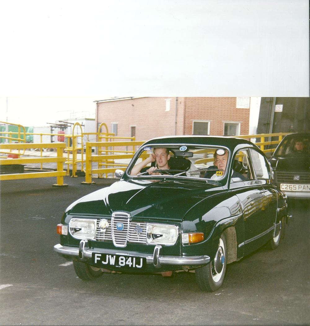 Stimpson as a teen behind the wheel with his father, Allan