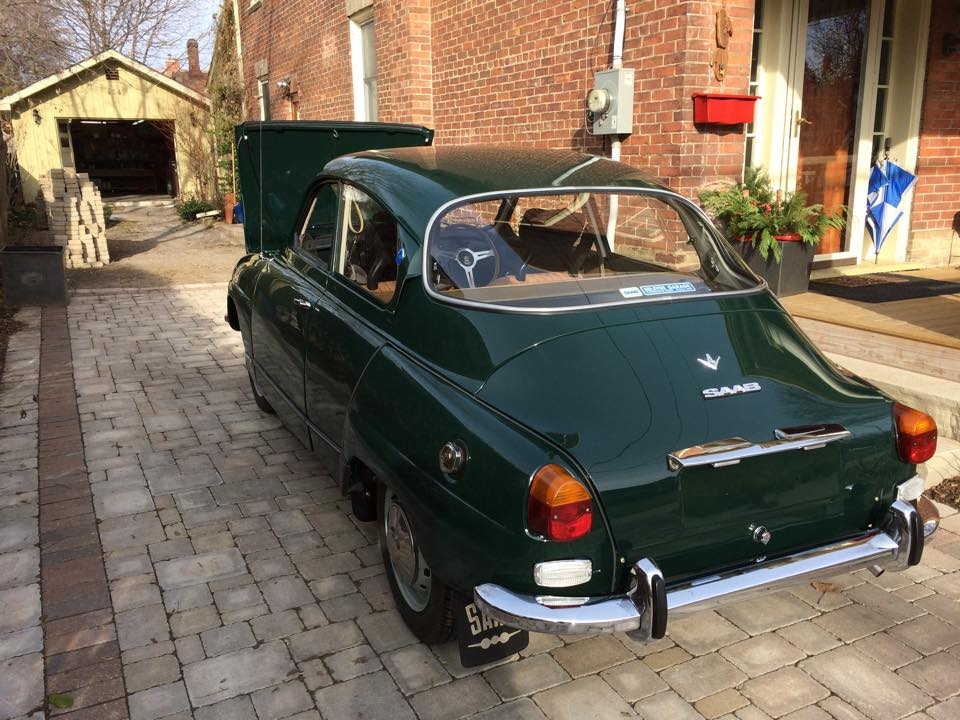 The beautiful restored car pictured with the garage Matt built to house it