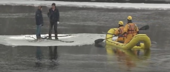 The teens chill out as the rescue raft comes. Screengrab via Chex Newswatch