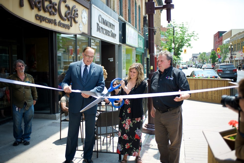 Mayor Bennett; Delia Senra, Co-owner of Natas Café; and DBIA Executive Director Terry Guiel at the Ribbon cutting ceremony for pop up patio. Photo by Evan Holt