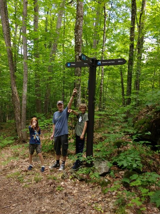 Jim, Charlotte and Alexander pictured on the Lusk Cave trail shortly after meeting the Trudeaus