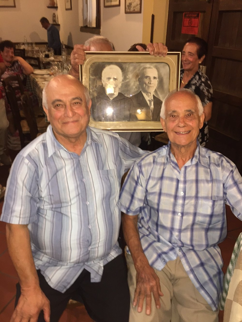 Sam and Joe together in Sicily (the picture in back is their grandfather Giuseppe Ferreri)