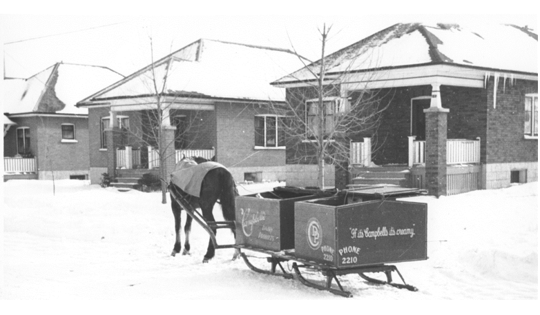 Campbell's Dairy, c. 1937, making deliveries in the winter snow. [Trent Valley Archives, Electric City Collection]