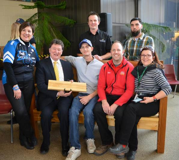 Standing (l-r):  Kerri Davies of CMHA HKPR, Fleming Carpentry professor Scott Fleming, Carpentry student Mike Payne.  Sitting (l-r):  Fleming President Tony Tilly, Carpentry student Brad Morey, Mike Kingdon of Chemong Home Hardware, and Dean of Trades and Technology Maxine Mann.
