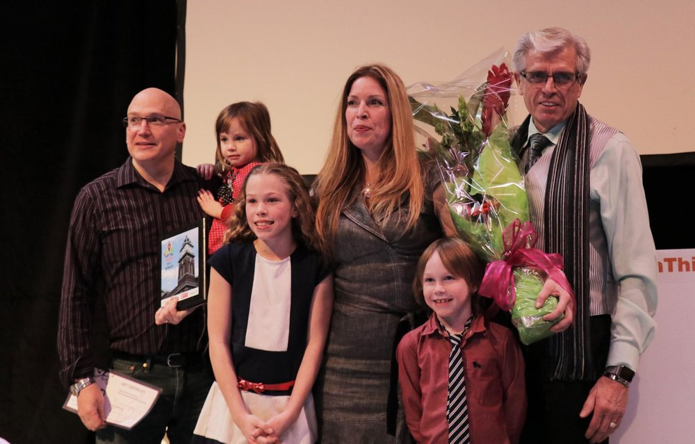 tina pictured with her husband, children and father after winning Win This Space
