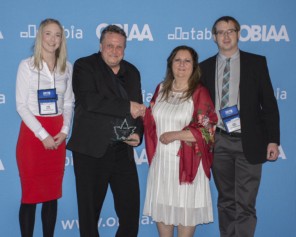 (L to R): Sam Sayer, DBIA Board Representative and owner of Sam's Place; Terry Guiel, DBIA Executive Director; Sue McDowell, OBIAA president; Joel Wiebe, DBIA Communications Manager.