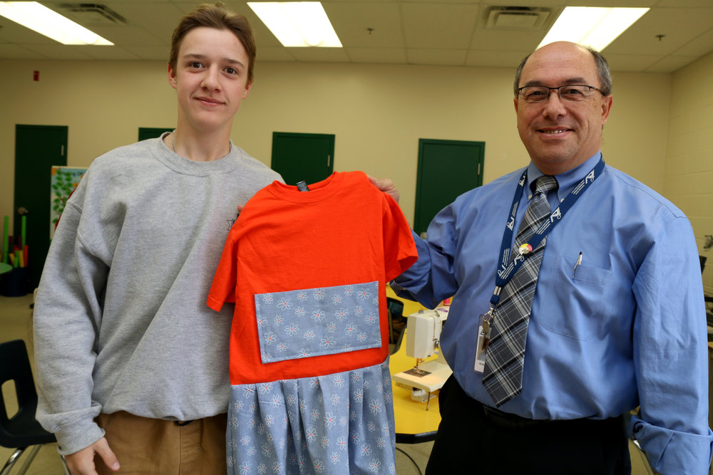Director of education Michael Nasello shakes hands with sewing partner Grade 8 John Hughes