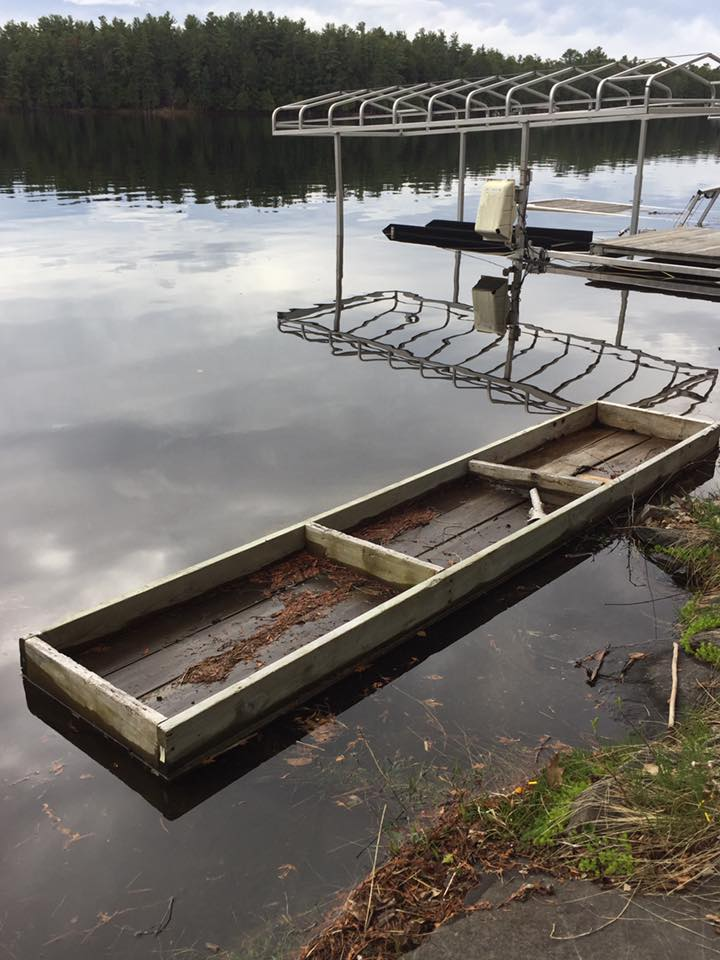 Dock that has floated to shore on Stoney Lake