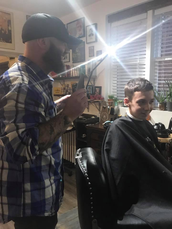 Magical moment: Aidan checking out his awesome haircut