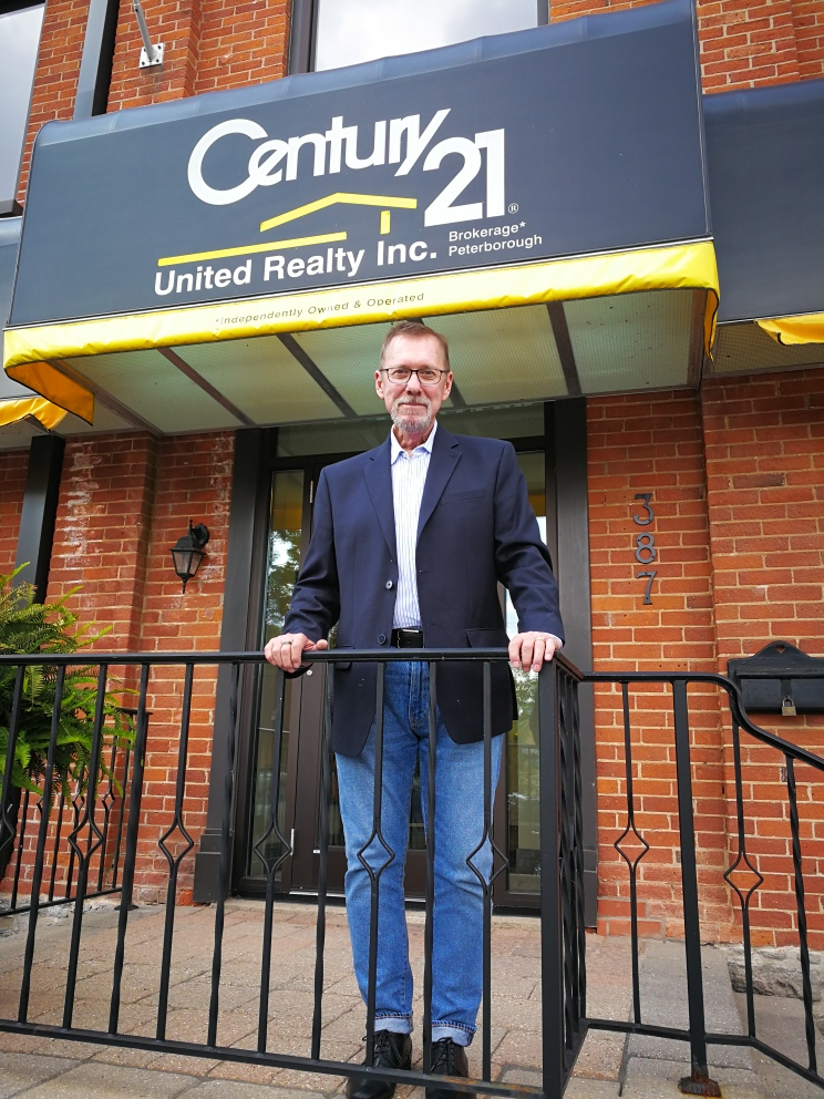 Bill Pyle at Century 21 office in downtown Peterborough