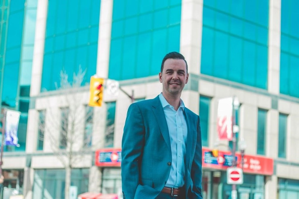 Gauvreau & Associates Founder Bob Gauvreau in front of the firm's new future home (Photo by Cody May, StudioPTBO)