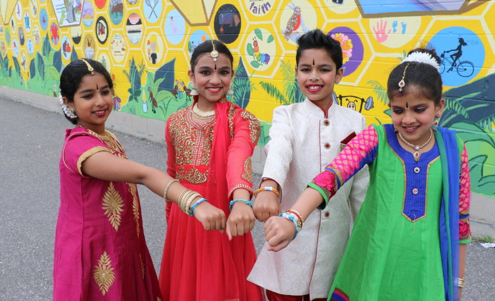 Left to right:  Dancers Shweta, Shreya, Calvin, and Prutha proudly wear their Tim Hortons Camp bracelets at New Canadians Centre