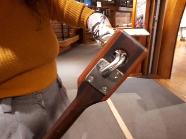 Photo of Rachel with her fitted paddle courtesy Canoe Museum