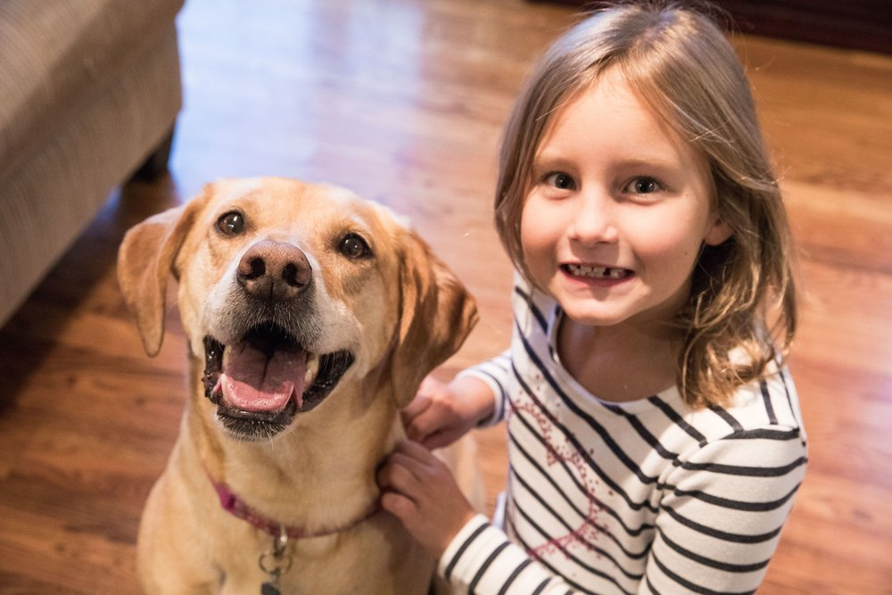 Rylee Morey, 7, with her dog, Augusta, 9