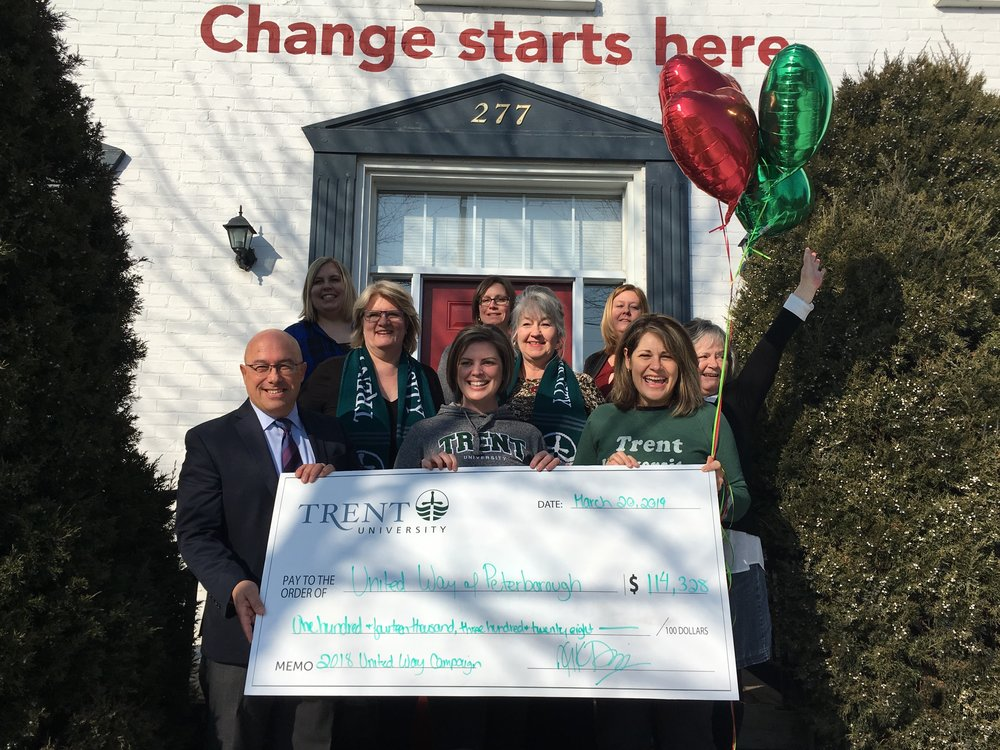 Michael Nasello (far left) And Julie Davis (far right) with Trent's internal United Way Committee (Photo courtesy United Way)