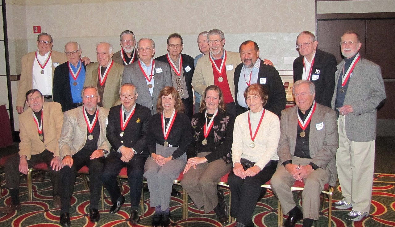 "…and here's the class of '59 (some from surrounding years) today. front row left to right: Gus Methe, Marty Okabayashi"" Lee Radtke , Nancy Tuisl Johnson , Corrie Lou Livingston Glass , Virginia Kemper Jachna, Bob Simonelli Middle row : Joe Sterling , Will Kaulfuss , Rob Kaulfuss , Don Stejskal, Tom Cannon , Dave Pond, Al Obergfel, Ken Kite Back row Left to right: Ken Boyer , Tom Knudtson, Bill O'Dell"