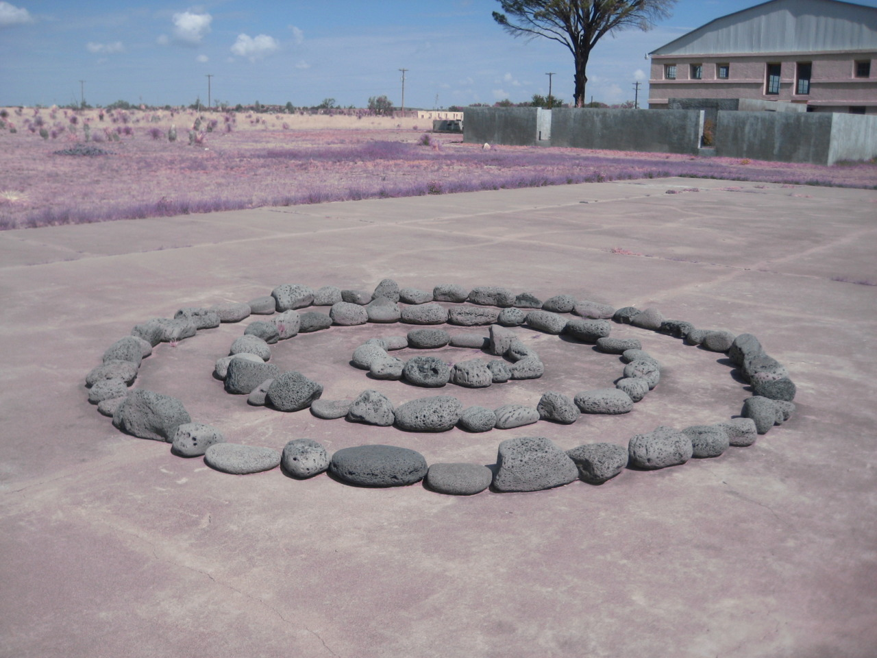 Richard Long , Sea Lava Circles. Judd saw this piece at an icelandic gallery, purchased it, and had it installed on a former tennis court at Chinati.