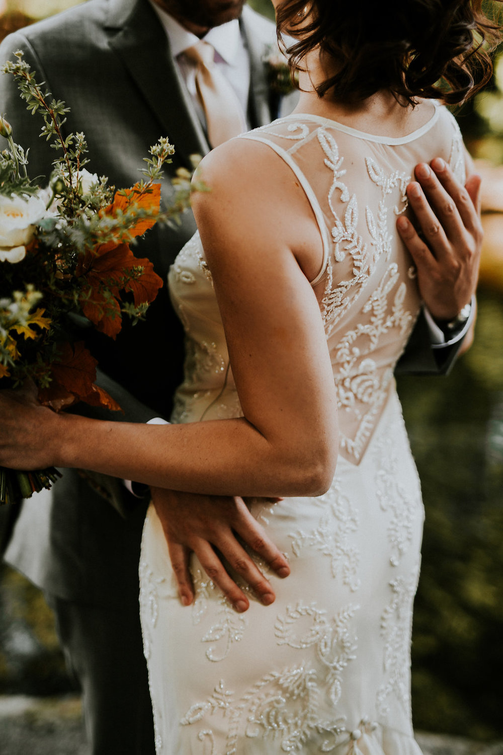 Fall wedding flowers with backless dress