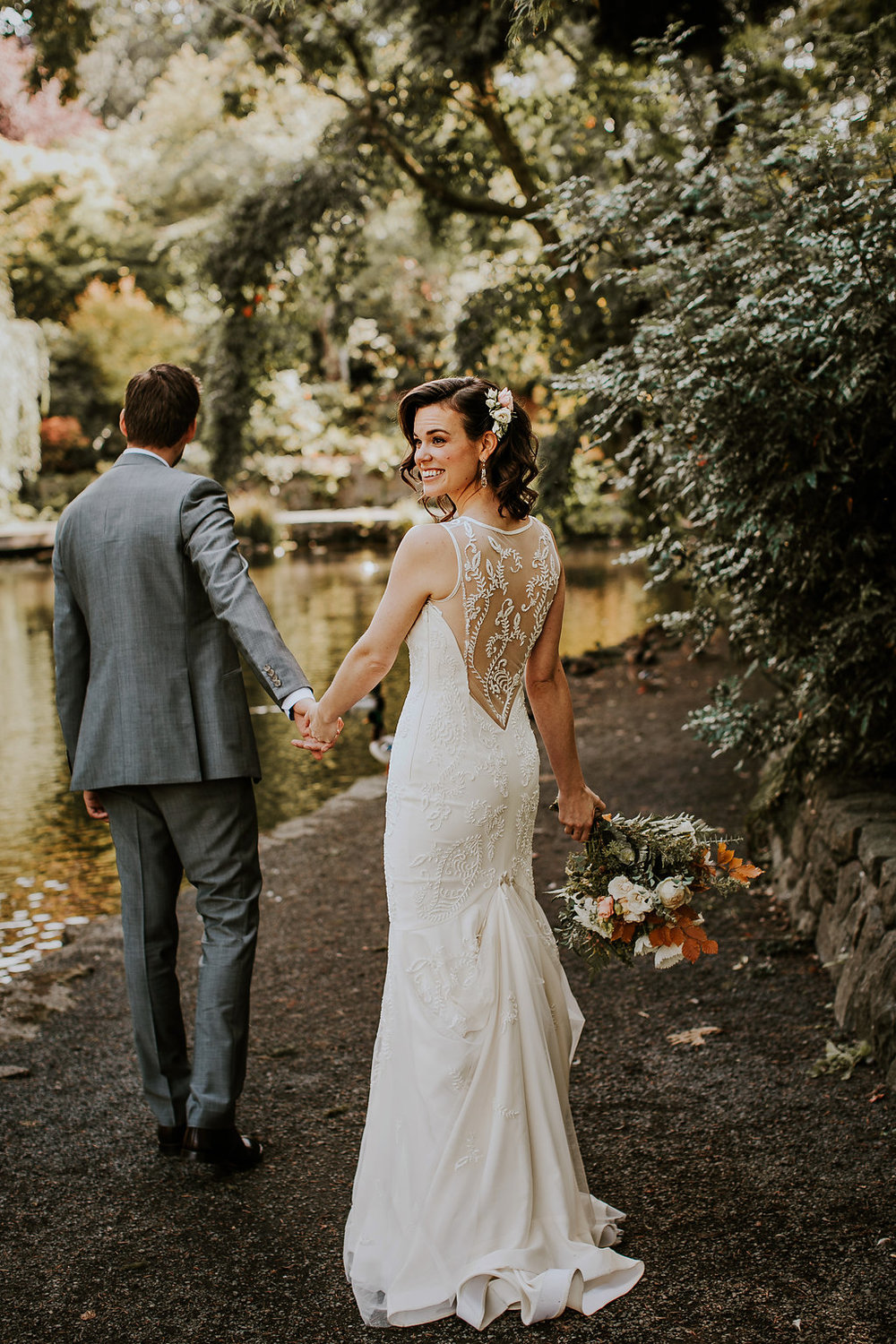 Hair flowers and backless dress at Portland Oregon wedding