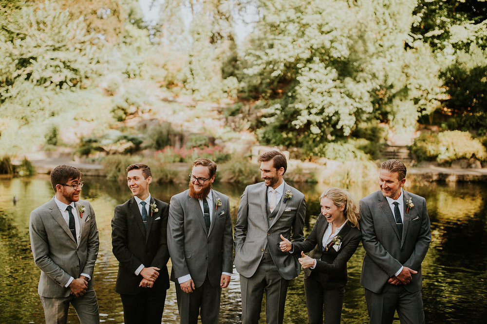 Gray wedding suits with boutonnieres