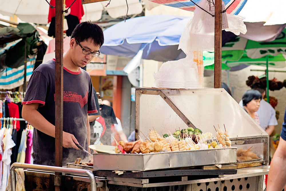 Stallholders sell food in Senado Square