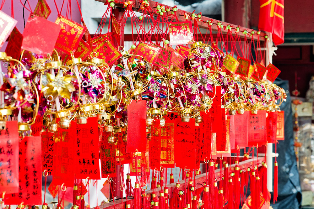 Tourists and locals buy these red ornaments to write 'prayers' on them before hanging them in the temple.