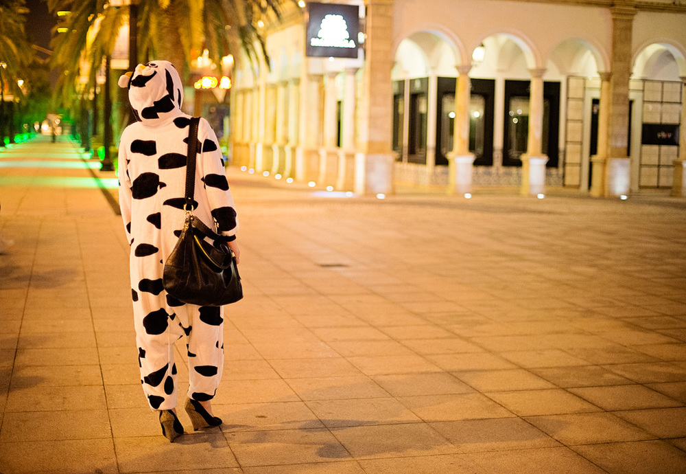 A travel writer who was also part of our tour group, exploring Fishermans Wharf in a cow suit #cowinmacau