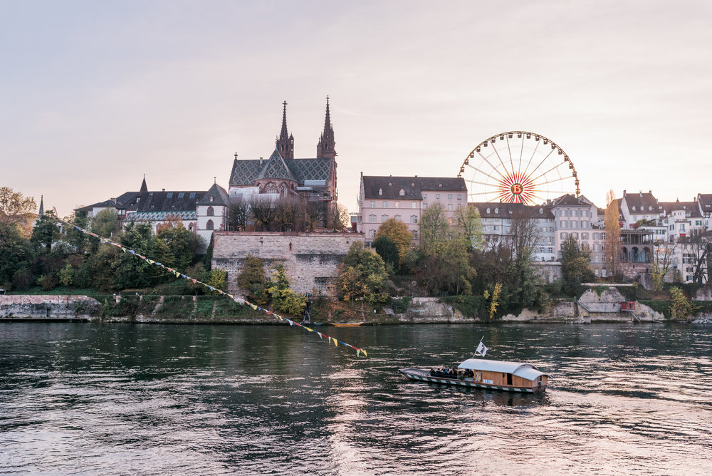 Basel skyline, city boat and the ferris wheel of the Autumn Fair.